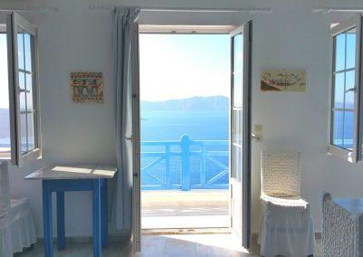caldera studios Fira hotel volcano sunset sea view Santorini_